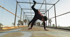 Slow Motion Young Asian Man Breakdancing Outside At Sunset Stock Footage