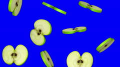 Round slices of green apple falling on blue screen, seamless loop, CG Stock Footage