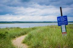 Rules sign and sandy path at Hampton Beach, New Hampshire. Stock Photos