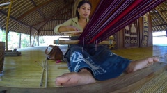 Local woman weaving on a handmade loom in Bali, Indonesia Stock Footage