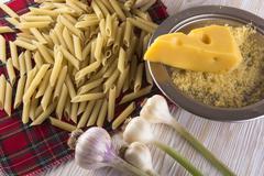 Pasta, grated cheese and garlic - stock photo