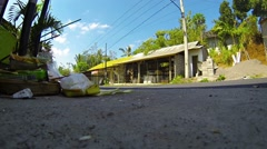 Unique, low angle shot of light traffic on a rural highway in Bali, with soun Stock Footage