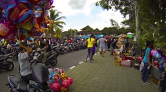 Vendors on the sidewalk in front of Taman Ayun Royal Temple in Bali Stock Footage