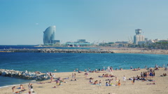 Barcelona, Spain : Beach Barcelona, people relax and bathe - stock footage
