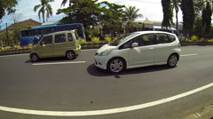 Collapsed section of sidewalk alongside a divided highway in Bali Stock Footage