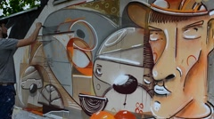 The artist draws graffiti, picture of the person with a pipe. Arkistovideo