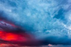 Sunset clouds with storm clouds - stock photo