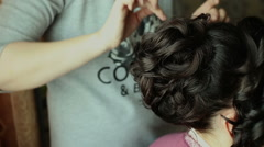 Hairdresser makes hairstyle, close up view - stock footage