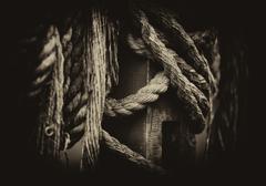 Horizontal vintage vignette sepia medieval ship ropes detail clo Stock Photos