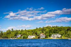 Houses along Lake Winnipesaukee in Weirs Beach, Laconia, New Hampshire. Stock Photos