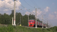 Traditional RZD suburban train meets Lastochka special express Stock Footage
