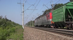 Heavy freight train of mixed type hopper wagons - stock footage