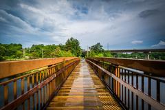 Pedestrian bridge over the Piscataquog River, in Manchester, New Hampshire. Stock Photos