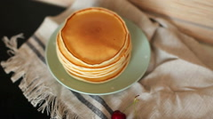Pile of Fresh Pancakes on a Plate on a Towel Stock Footage