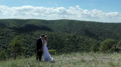 bride and groom on the background of mountain view. - stock footage