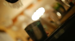 Ice falling in cocktail shaker at bar Stock Footage