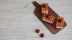 Waffles With a Cherry on a Board Stock Footage