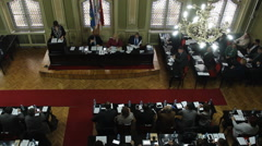 MPs, councilors in the Assembly shot from above  Stock Footage