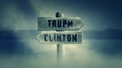 Old Wooden Sign on a Middle of a Cross Road With the Words Trump or Clinton Stock Footage