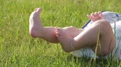 Small baby's cute feet on the grass Stock Footage