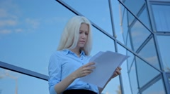 Blonde businesswoman throwing documents Stock Footage