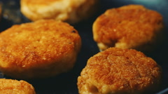 Meat cooking. Fresh juicy meat chop (cutlet) are frying in a pan. Close-up pa Stock Footage