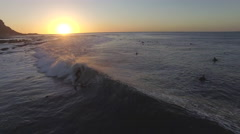 Aerial of Close Surfing Follow in Elands Bay Stock Footage
