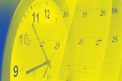 Clock face and calendar pages Stock Photos