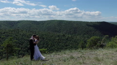 Bride and groom on the background of mountain view. Stock Footage