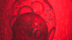 Translucent red balloon background 40 logo slowly rotating Stock Footage