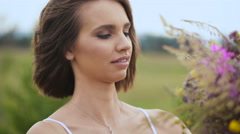 Bouquet of wild flowers in the hands of women Stock Footage