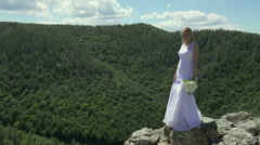 bride holding flowers on the background of Mountain View - stock footage