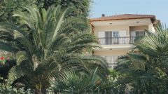 Big luxury house with beautiful backyard full of palms, establishment by Sheyno. Stock Footage