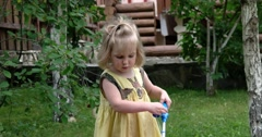 A Cute Baby Girl Plays With Her Toy Fishing Set Outdoor Stock Footage
