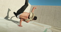 Young Asian Man Breakdancing Against Wall Stock Footage