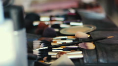 Closeup of professional cosmetics makeup brushes kit in motion - stock footage