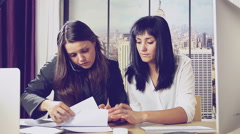 Worried business women at work in office retro style Stock Footage