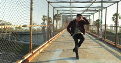 Young Happy Asian Man Dancing On Bridge at Sunset Stock Footage