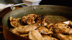 Fried chicken breast in a metal kitchenware Stock Footage