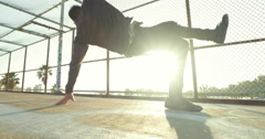 Young Man Breakdancing At Sunset Stock Footage