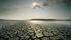 Dry, cracked earth and clouds, Alvard Desert, Oregon - stock footage