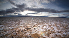 Dry, cracked earth and clouds, Alvard Desert, Oregon Stock Footage