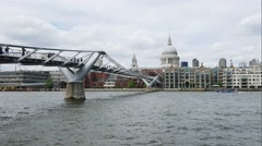 Timelapse of Millennium Bridge leading to Saint Paul's Cathedral Stock Footage