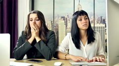Worried business women at work in office Stock Footage
