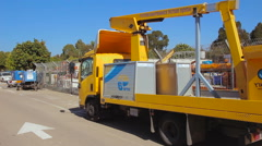 Road service and maintenance truck with mobile crane Stock Footage