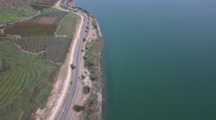 Sea of Galilee - Lake Kinneret West coast - Moves South to North and back Stock Footage