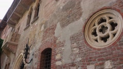 Juliets house with famous Romeo and Juliet balcony in Verona Italy Stock Footage