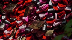 Padlocks attached to the wall of Juliets house in Verona as a proof of love Stock Footage