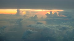 Aerial view of  white clouds on blue sky on sunrise with reflection in ocean - stock footage
