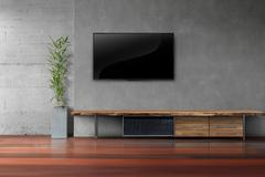Living room led tv on concrete wall with wooden table Stock Photos